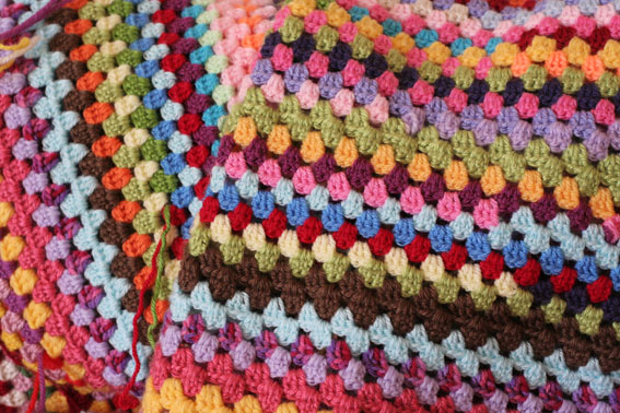 Colourful granny stitch blanket. Free pattern. How to crochet a large suaqre so it lays flat.