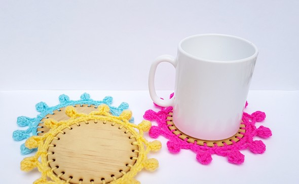 Crochet trim on wooden laser cut coasters. Tutorial with free laser cutting file.
